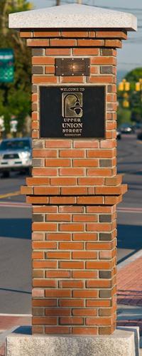 brick pillar with sign reading Upper Union Street